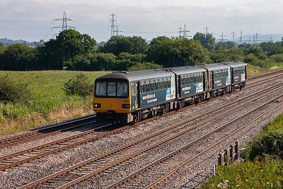 A pair of Pacer units, 143619 and 143618, pass heading west with an unknown working.