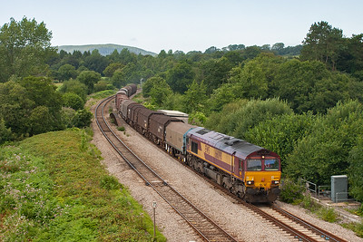 A final shot at Pont Tal Y Bont and 66090 hauls its train over the Ely River. The working is 6M41 1222 Margam to Round Oak loaded steel.