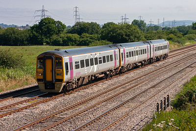 This is the first train of the day from Portsmouth Harbour to Cardiff and 158965 forms 1F08, 0650 off.