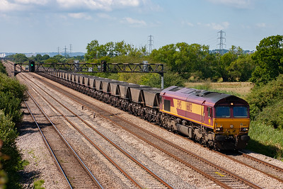 Due to the previous steel train running on the Up Relief, 66102 is routed along the Up Main with a rake of empty HAA coal hoppers. It could be 6C55 Aberthaw to Avonmouth empty MGR running as a class 6 rather than a class 4 due to the type of wagons.