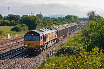 The first of the day's freight action and 66055 powers an overnight enterprise working from Immingham to Margam, 6V19 1802 off the east coast port.