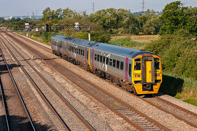 Alphaline liveried three car 158961 comes by with 1F07 0830 Cardiff to Portsmouth Harbour.