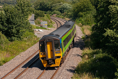 Arriva sprinter 158853 in Central Trains green forges up the 1 in 163 gradient here at Llangewydd with a Carmarthen bound class 1 working, 1V80 1334 from Manchester Piccadilly.