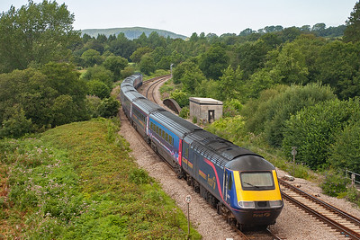An unknown HST passes by, the train is known however, 1B28 1145 Paddington to Swansea.