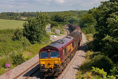 Most of the freight in this area is either steel or coal, this empty steel train is 6V75 0930 Dee Marsh to Margam and is powered by 66170.