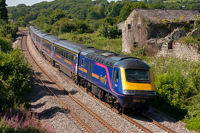 Studying the OS maps and driving about brought me to this delightful spot at Llangewydd. 43192 leads an up service from Swansea to Paddington, 1L66 1330 off, past a derelict Llangewydd Grange.