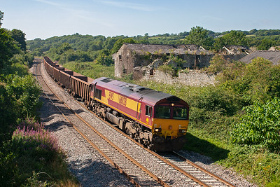 Viewed from the interesting side of the bridge is 66028 dropping down the 1 in 168 grade with 13 empty KEA bogie boxes working 7B07 MThO 1451 Margam to Machen Quarry.