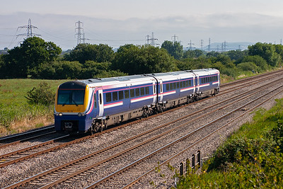 A three car class 175/1 Coradia unit wears First Group colours but has been debranded. 175113 forms what I thought was 1V73 0638 Manchester Piccadilly to Milford Haven, but it can't be as I saw it heading back the way a short time later so it must have gone as far as Cardiff.