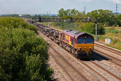 66208 has its work cut out with this heavy train of 25 BDA flats each loaded with three steel slabs heading for the plant at Llanwern. It has come from Margam steel works, 6H25 0953 off.