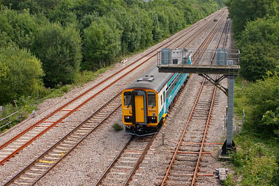 Looking towards Cardiff and along Miskin loops. 153353 hurries by with 2B65 1314 Cardiff Central to Swansea local service. The bubblecar looks exworks.