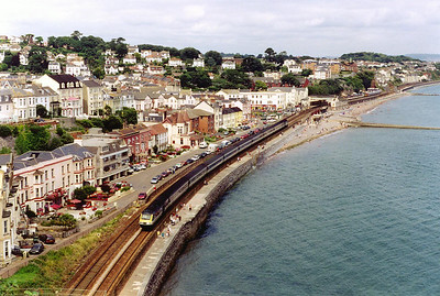 "The sea looks peaceful and calm and not causing any danger to passing trains, the ""Dawlish Carriage Wash"" is not operating today! An unknown FGW HST passes the turquoise waters of the bay with 1C28 1133 Paddington to Penzance service."