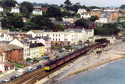 Virgin 47829 and its uniformly matched rake of mkII coaches pass through Dawlish station bound for Plymouth with 1V46 0913 off Liverpool Lime Street.