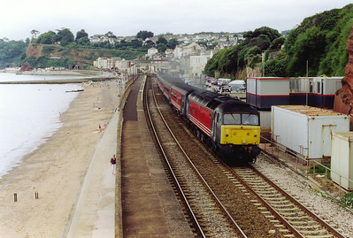 More type 4 loco action and Virgin liveried 47807 hauls cross country service 1M56 0846 Penzance to Manchester Piccadilly past Dawlish station and the carpark that used to be the goods yard.