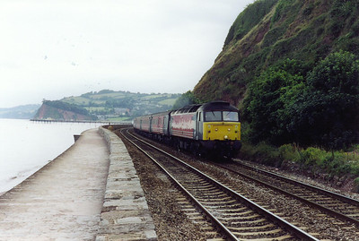 Even in 2001 a loco hauled train was something to savor, it was the last full year of loco hauled VXC services before the Voyager invasion. 47829 follows the contours of the cliffs at a height of about 25 feet above the sea and beach. The loco is working is 1E61 1550 FX Plymouth to Leeds.