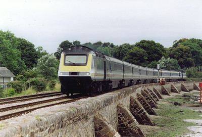 A down FGW service runs beside the River Exe with powercars 43035 and 43138 on 1C09 0745 Paddington to Penzance via Bristol.