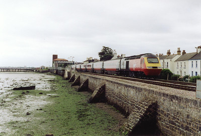 A Virgin Cross Country working comes through Starcross station with 43166 leading 1E31 0821 Plymouth to Newcastle.
