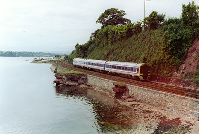 SouthWest Trains 159012 runs along the east shore of the River Teign with Teignmouth station being its next stop. This is a Wales and West crewed and operated 1456 Plymouth to Exeter St Davids train.
