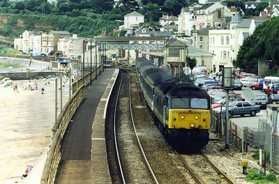 Moving to Dawlish and the footbridge to the east of the station. 47732 in FGW livery powers through the station with 1A45 0820 off Penzance to Paddington. The length of the down platform here gives an idea to how busy this station was in previous years.