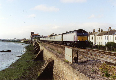 Early the next morning at Starcross on the shore of the River Exe and lone experimental type 4 locomotive 57601 fronts its usual weekday working 1A34 0730 Plymouth to Paddington.  31/7/2002