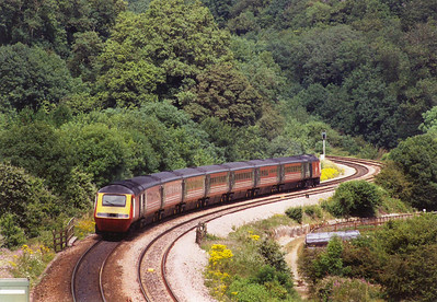 A Scotland bound Virgin HST drops down the 1 in 44 ruling grade, 43068 and 43088 power 1S41 1412 off Plymouth for the Scots capital.  The atmospheric form of traction failed and locomotives had to be used and the Devon Banks became an operating nightmare.