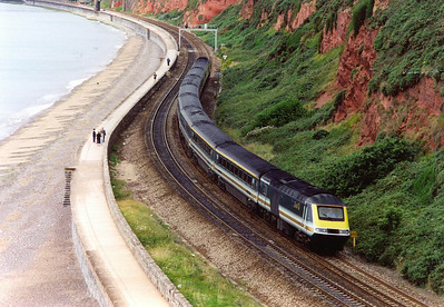Back to a familiar and favourite spot, the Sea Wall section at Dawlish. 43172 and 43190 form the first passenger service of the day off Penzance, 1A36 0622 to Paddington. The train passes Langstone Rock running about 20 minutes late.