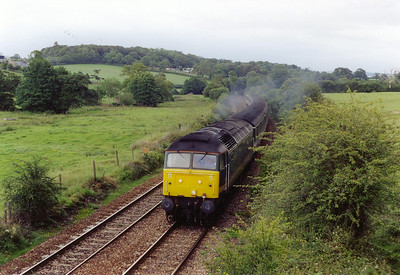 A class 47 grunting hard against the 1 in 50 pull sees 47832 working 1C33 1233 Paddington to Plymouth working. Steam locos at Totnes Riverside station could be heard whistling in the distance.