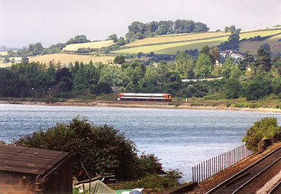 Moving round to the west side of Teignmouth station and the River Teign is the piece of water seen in this photo. Looking towards Bishopsteignton 159008 follows the coastline as it runs towards Plymouth with a working from Waterloo, 1L17 left at 0710.