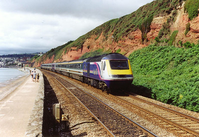 "The new First Group livery was starting to make an appearence in 2002 and 43137 and one coach in the set wears the new ""Barbie"" colours. The working is 1A45 0820 Penzance to Paddington."