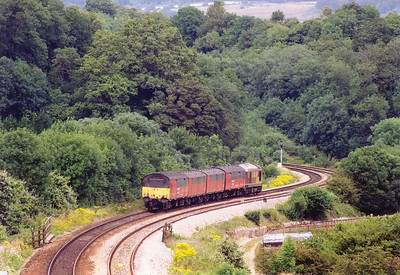 67003 and its four van load drops effortlessly down the steep and twisting Dainton Bank. The train is 1C06 1353 Plymouth to Bristol Parkway RMT loaded mail vans.  This section of railway was originally designed by Brunel for atmospheric traction and easy gradients were not thought important.