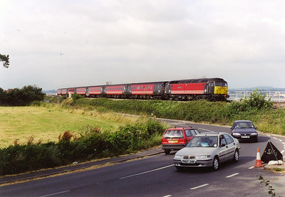 A well matched Virgin Cross Country loco hauled service approaches the harbour and the ever present line up of photographers. It is working 1V50 0840 Glasgow Central to Penzance train.