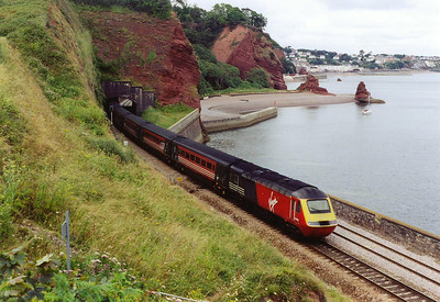 Moving to a new location beyond Dawlish station and Horse Cove where the line cuts through the sandstone cliffs in several places.  43088 is the rear powercar of a Virgin working, 1E36 1300 Plymouth to Newcastle. The front of the train is within Clerk's Tunnel.