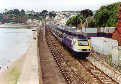 "First Great Western maintains the tradition of having named trains. This is the up ""Cornish Riviera"" passes through Dawlish station with powercar 43020 leading."