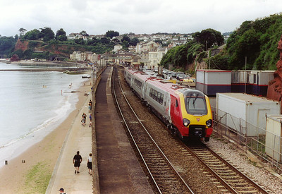 A Liverpool bound super Voyager unit, 221105, runs past what would have been the entrance to Dawlish goods yard, now a car park, with 1M40 1151 off Plymouth.