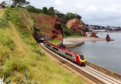 Finally the sun has come out and paints the lovely scene with decent light. 220020 leaves the 55 yard long Clerk's Tunnel, one of four between Dawlish and Teignmouth, with 1V46 0913 Liverpool to Plymouth.