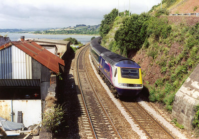 The rough corrogated iron buildings belong to a boat yard between the railway and the river. It does nothing to enhance the scene as 43138 approaches Teignmouth. The working is 1A45 0820 Penzance to Paddington.