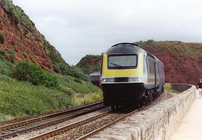 Langstone Rock rises behind 43146 as it brings its train round the curve and starts the run along the Sea Wall section at Dawlish. The working is 1C09 0945 Paddington to Penzance running about 16 minutes late. This is the first down train from London to Penzance.