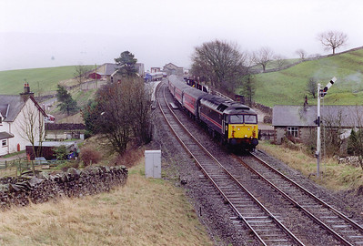 Still at Kirkby Stephen, but a move to the overbridge just to the north of the station gives this view. Fragonset 47709 passes the down starter with 1S54 0550 Bournemouth to Glasgow Central cross country working.