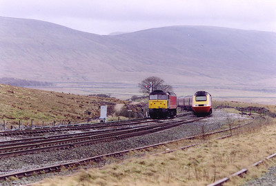 Ingleborough rises in the background as 43062 comes round heading north with a diverted long distance 1S71 0720 Penzance to Glasgow Central. The point where the single track becomes double is visible in the foreground. 47822 departed south just after the HST cleared the section at Settle Junction.