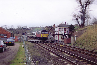 The up ROYAL SCOT comes over the level crossing at Culgaith and passes the former Midland Railway signalbox. 47778 leads an InterCity liveried mkIII and DVT set, 1M22 0839 off Glasgow Central to London Euston.