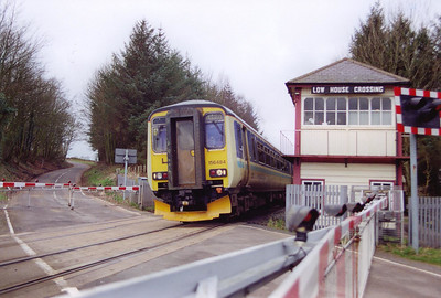 The former Midland Railway signalbox at Low House Crossing stands guard over the road. 156484 was held here to allow a diverted working to clear the section ahead of it. The set is working 2H85 0925 SO Carlisle to Leeds.