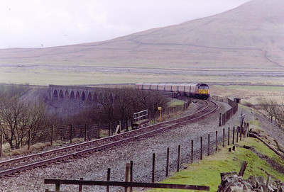 We have already seen the up ROYAL SCOT at Culgaith, this is the down working, 1S57 1030 Euston to Glasgow Central. 47778 brings the train over the famous Ribblehead Viaduct with the line climbing at 1 in 100. The line was singled over the viaduct many years ago to ease the stresses on the structure.