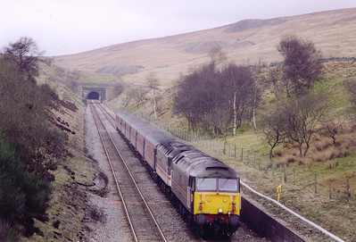 A double headed southbound working comes through the cutting to the north of Blea Moor 'box with the southern portal of Blea Moor tunnel visible in the background. 47709 fronts 47831 on 1M33 1410 Edinburgh to Birmingham New Street, the up Midland Scot.