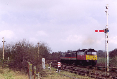 RES liveried 47634 approaches Howe & Co Sidings to the south of Carlisle with a diverted Cross Country working, 1O38 0735 Glasgow Central to Bournemouth.  The down starter is on and a shunting signal is almost lost in the bushes of the former gypsum works exchange sidings.