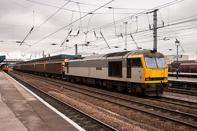 Unbranded two tone rail freight grey 60013 waits for the road with a short enterprise service consisting of 7 ferry wagons and a steel bolster wagon. The train is 6D65 1119 Doncaster Belmont Yard to Immingham.