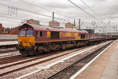 Another Immingham bound enterprise working crosses the through roads with 66179 fronting 6D45 1250 Belmont Yard to Immingham with 6 BEA steel carriers on the drawbar.