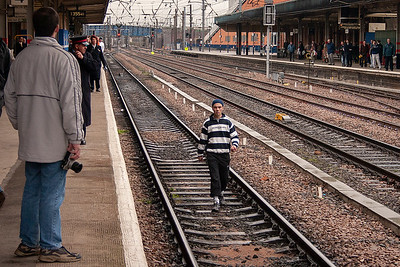 All station signals are red and the job has been stopped as this arse walks along the down slow having jumped onto the tracks after he assaulted a female member of staff on the front concourse.  His mother will be so proud of him.