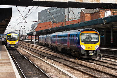 Transpennine services to and from Cleethorpes, or Manchester Airport if you like pass each other. On the left is 185123 with 1B74 1052 Manchester Airport to Cleethorpes whilst departing to the right is 185121 with a return working of 1B77 1128 Cleethorpes to Manchester Airport.