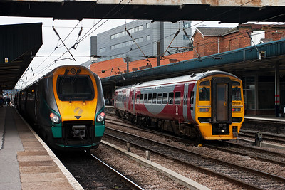 """Hull Trains started off as an Open Access operator but was later bought over by First Group. HT bought a fleet for Voyager units and gave them class 222 numbers and called them """"Pioneers"""". Here 222101 pauses with 1H04 1333 Kings Cross to Hull whilst to the right crossing into platform 2 is 158909 with 1J42 1441 from Sheffield to Hull."""