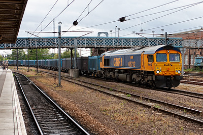More GBRf action with 66712 coming round the west side with 4M91 1316 West Burton Power Station to New Biggin loaded gypsum. Gypsum is found naturally but is also a byproduct of the power station desulphurisation process. It is taken to the New Biggin plant on the S&C to be made into building supplies, i.e. plasterboard.
