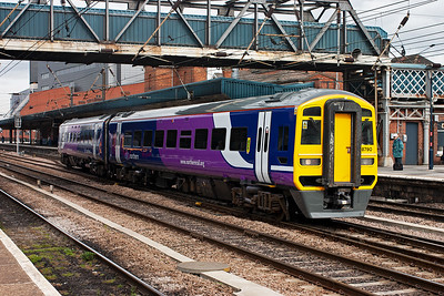 A colourful class 158 set departs Doncaster and crosses all the main running lines to gain the line which heads south west towards Sheffield which is the destination for 158790 and 1J26 1109 off Bridlington.